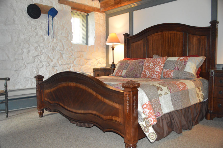 Cozy up on the comfortable king size bed surrounded by 18 inch exposed stone walls and wood beams. Enjoy a warm bath in the extra large bathroom with tub or relax in the sitting area in the comfortable large sofa-chair that pulls out into a single bed for an invited extra guest. After a great night sleep wake up to enjoy a full country breakfast.